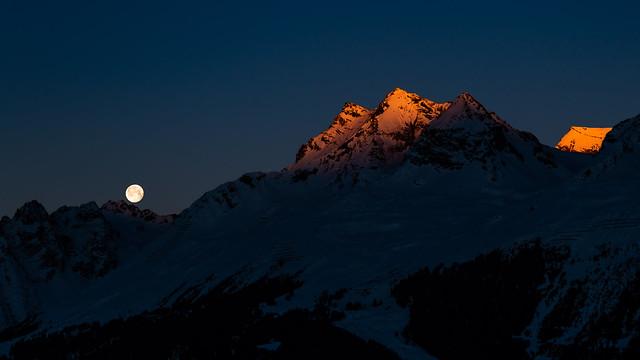 moon setting, sun rising