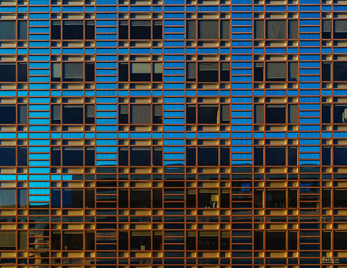 facade building lines shape pattern parallel blue orange yellow green color windows
