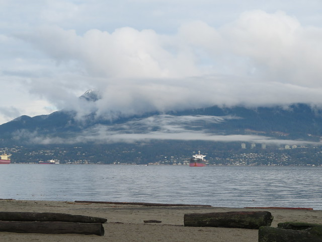 Snow on the mountains, clouds over the inlet
