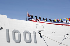 The crew of USS Michael Monsoor (DDG 1001) salute as the ship is brought to life during its commissioning ceremony. (U.S. Navy/MC1 Peter Burghart)