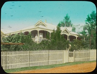 Couple on the veranda of a Queenslander house, Queensland, ca. 1910