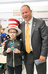 After he finished reading three Dr. Seuss stories to 3rd graders at Mary Fritz Elementary,  Rep. Fishbein gave the Cat in the Hat hat off his head to Dalton Moynihan, 9.