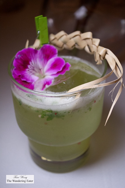 Mezcal, lime, cilantro cocktail with a braided palm bark