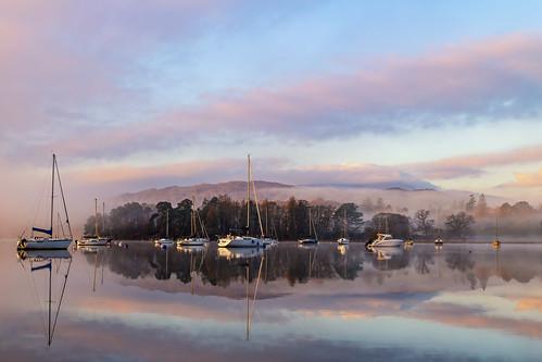 ambleside england unitedkingdom gb reflection reflections trees lake sky clouds sunrise landscape windermere mountain mountains mist misty foggy fog boat yacht