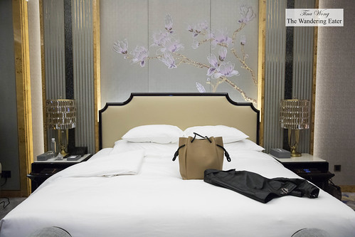 The large bed with my Loewe purse and leather jacket | by thewanderingeater