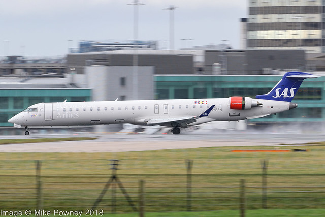 EI-FPN - 2017 build Bombardier CRJ900LR NG, arriving on a saturated Runway 23R at Manchester