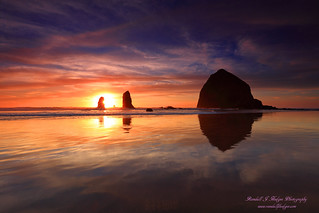 Sunset and Sun Star with Haystack Rock and the Needles from Cannon Beach in Oregon | by @randalljhodges