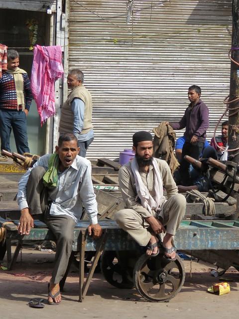 waiting porters in old delhi