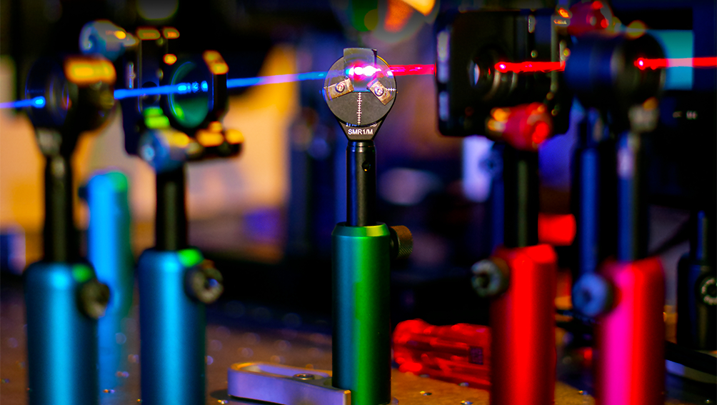 A laser beam changes colour as it interacts with the nanomesh