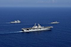 USS Wasp (LHD 1) maneuvers alongside the Philippine Navy's landing platform dock BRP Tarlac (LD 601) and offshore patrol vessel BRP Ramon Alcaraz (PS 16), April 5. (U.S. Navy/MC1 Daniel Barker)