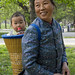 Grandmother With A Baby In A Basket On Her Back, Beijing China