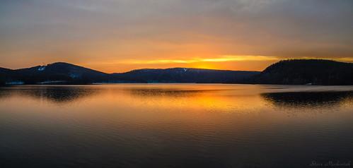 smack53 sunset evening eveningsky paintedsky sky clouds water reflections mountains panorama monksville monksvillereservoir reservoir lake pond winter wintertime winterseason nikon d3100 nikond3100 ringwood newjersey