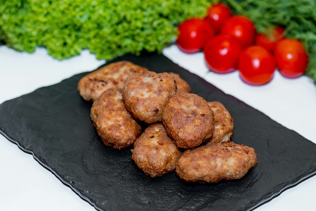 Homemade meat cutlets with vegetables and herbs