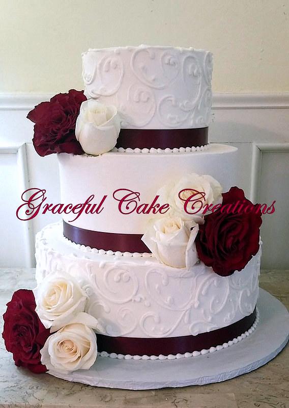 Elegant White Butter Cream Wedding Cake With Burgundy Ribb Flickr