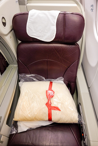 Pillow and comforter on the seat | by A. Wee