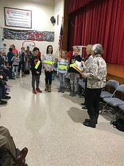 Diane and Cathi presenting gift cards to the winner and two runner ups.  The fourth runner up, Lily Bechtold (second from left) was named an alternate if one of the students cannot attend the District Spelling Bee in February.