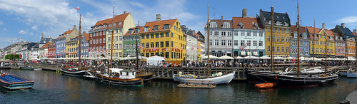 The bright houses lining the canal of Nyhaven in Copenhagen, Denmark