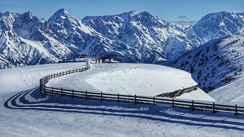 winter moutains alps austria skiing slope fence snow