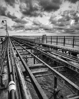 Lines and sky #railwayphotography #railway #train #pier #ryde #isleofwight #isleofwight #iow_bnw #iowshots #clouds #cloudporn #sea #islandline e