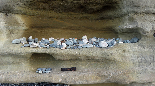 Stones piled in a hollow cave at Sandcut Beach near Sooke on Vancouver Island, Canada