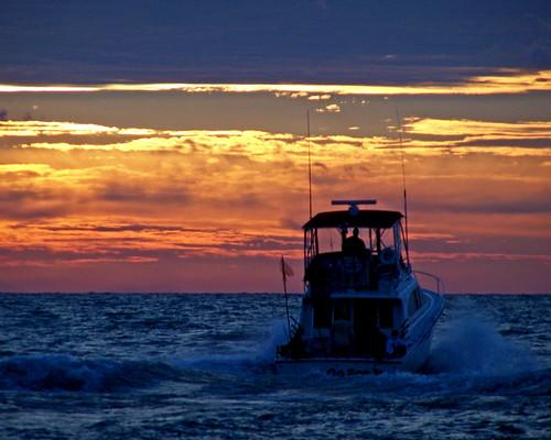 lake guy water clouds sunrise boats boat flag lakemichigan waukegan interestingness8 i500