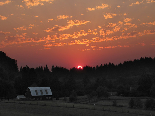 sunset red barn woodland smokey wa hazy cedercreek