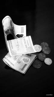 money | by Massimo Vitellino