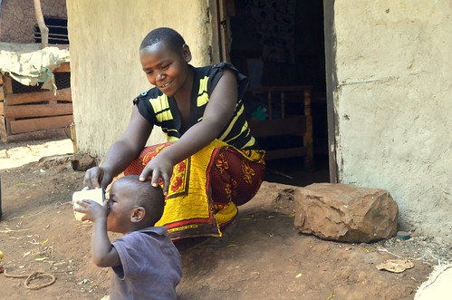 Cassava farmer  feed her child with porridge made from cassava flour in Thika, Central part of Kenya. Cassava is attacked by CMD and CBSD & Maize has failed.Scientists have developed a cassava variety resistant to the menace- By Verenardo Meeme