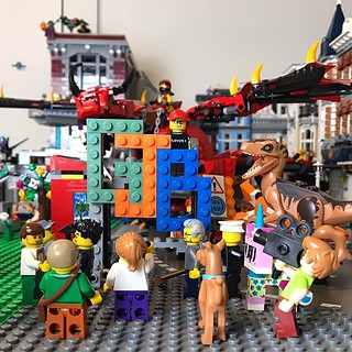 """The final logo. I stuck with the green because I love the colour. We decided to curve the """"j"""" up too which makes it more of a J now. This photo features a crowd of Studsburg Brickizens along with many of our visiting SigFigs! And yes, even a dragon turned   by GJBricks"""