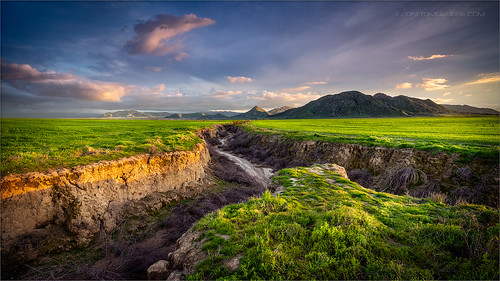 field farm countryside gorge chasm ravine tumbleweeds spring grass storm clouds morenovalley california landscape
