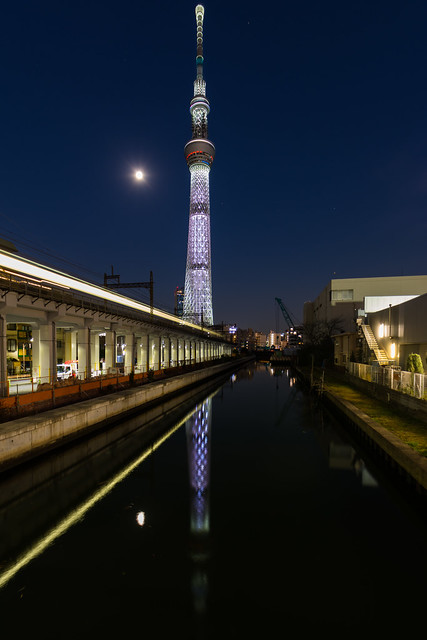 Skytree, moon and passing train