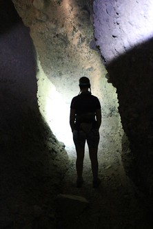 1289 Vicki's silhouette in the light of her headlamp as we hike through the dark section of the slot canyon | by _JFR_