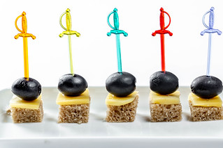 Small canapés to snack on white background | by wuestenigel