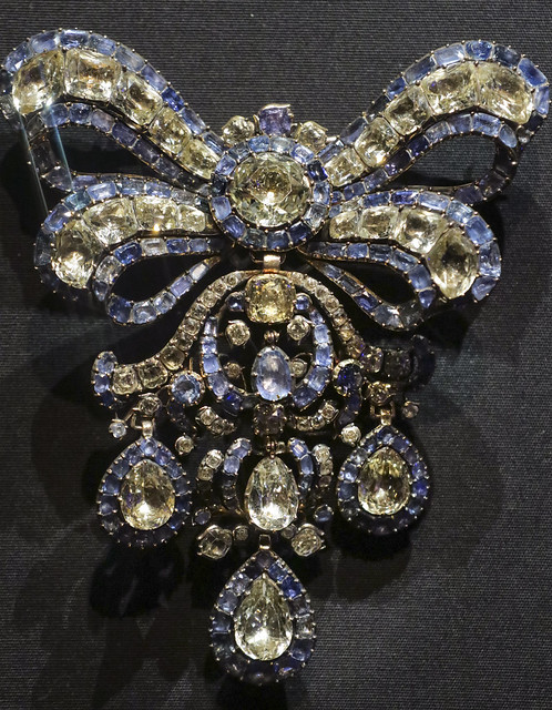 Bodice ornament and a pair of earrings, probably France, about 1760, topazes backed with foil and sapphires