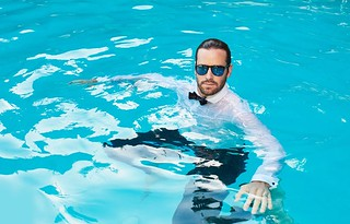 Armie Hammer in the pool fully clothed | by cestrius
