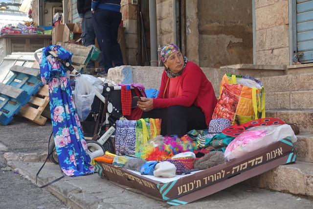 Bukharan woman with informal stall, Mahaneh Yehuda, Jerusalem