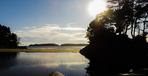 The setting sun at a beach at the end of Tonquin Trail in Tofino on Vancouver Island