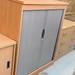 Oak two door tambour cw shelves E165