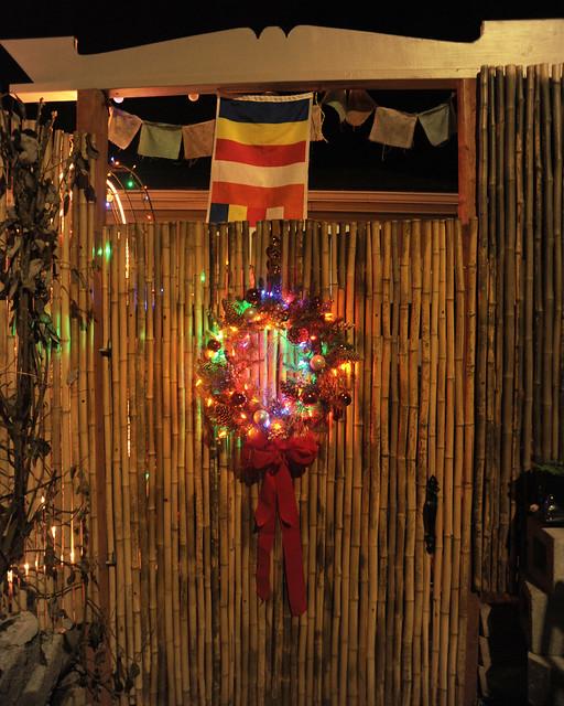 What I see coming home, Christmas-Buddhist gate, Christmas wreath, Buddhist prayer, International Buddhist flag, over gate, bamboo fence, top rail, Seattle, Washington, USA