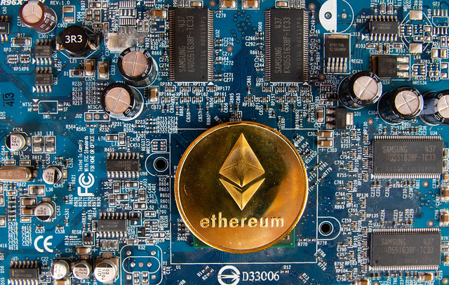 Ethereum coin on a computer mother board