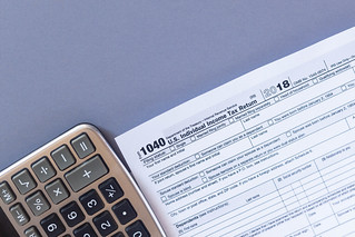 Tax form 1040 and a calculator. US tax form law document. Business concept | by wuestenigel