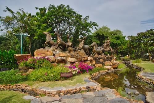 bronze sculpture horses water flow feature stones garden gods park open air museum muang mueang boran ancient city siam trees samut phrakan province thailand southeast asia sony alpha 77 slt dslr