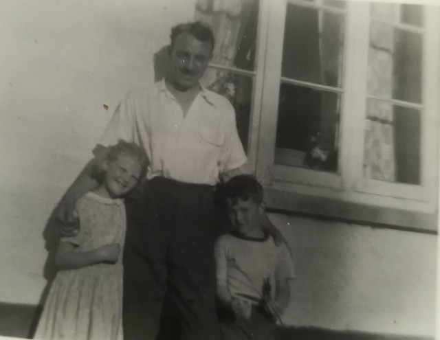 A photo of my father, myself, and my cousin Shirley outside our grandparents in Devon