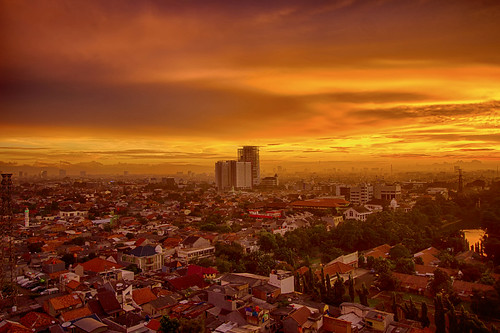 skyline indonesia jakarta sunset fire bright orange cityscape buildings sun