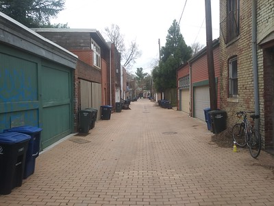 Yellow brick style alley with carriage house and garage structures, 200 block of 10th Street SE