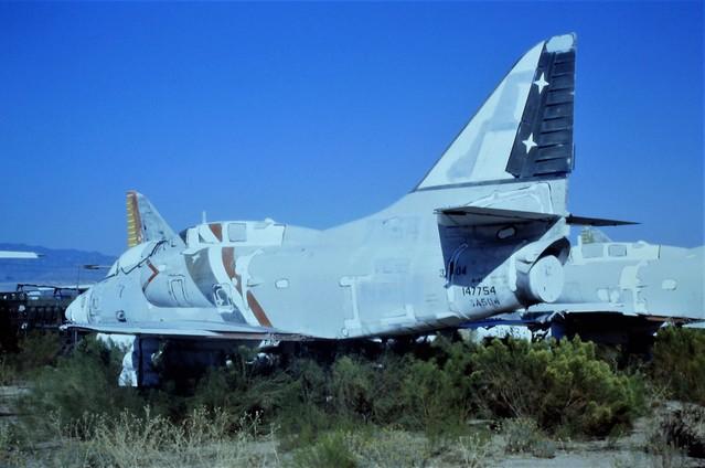 A-4L Skyhawk 147754/JE-05 ex VC-2 U.S.NAVY (MASDC code 3A504).Seen stored Tucson, Dross-Metals-Inc. (DMI), Arizona. 23 October 1995.
