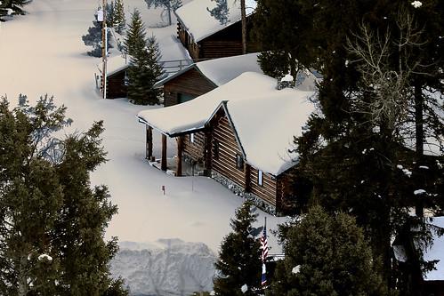 wyoming crandall clarksforkoftheyellowstone shoshonenationalforest parkcounty cabins homes summerhomes snow winter melt flags trees puddles wyojones np