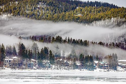 montana whitefish whitefishlake citybeach lowclouds clouds ice winter trees slopes mountain houses shoreline feburary snow wyojones mp np