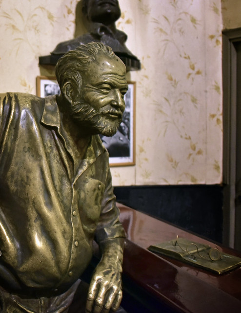 A bronze Ernest Hemingway leaning on the bar at El Floridita in Havana (La Habana Vieja) on a Saturday night 03-30-2019 087