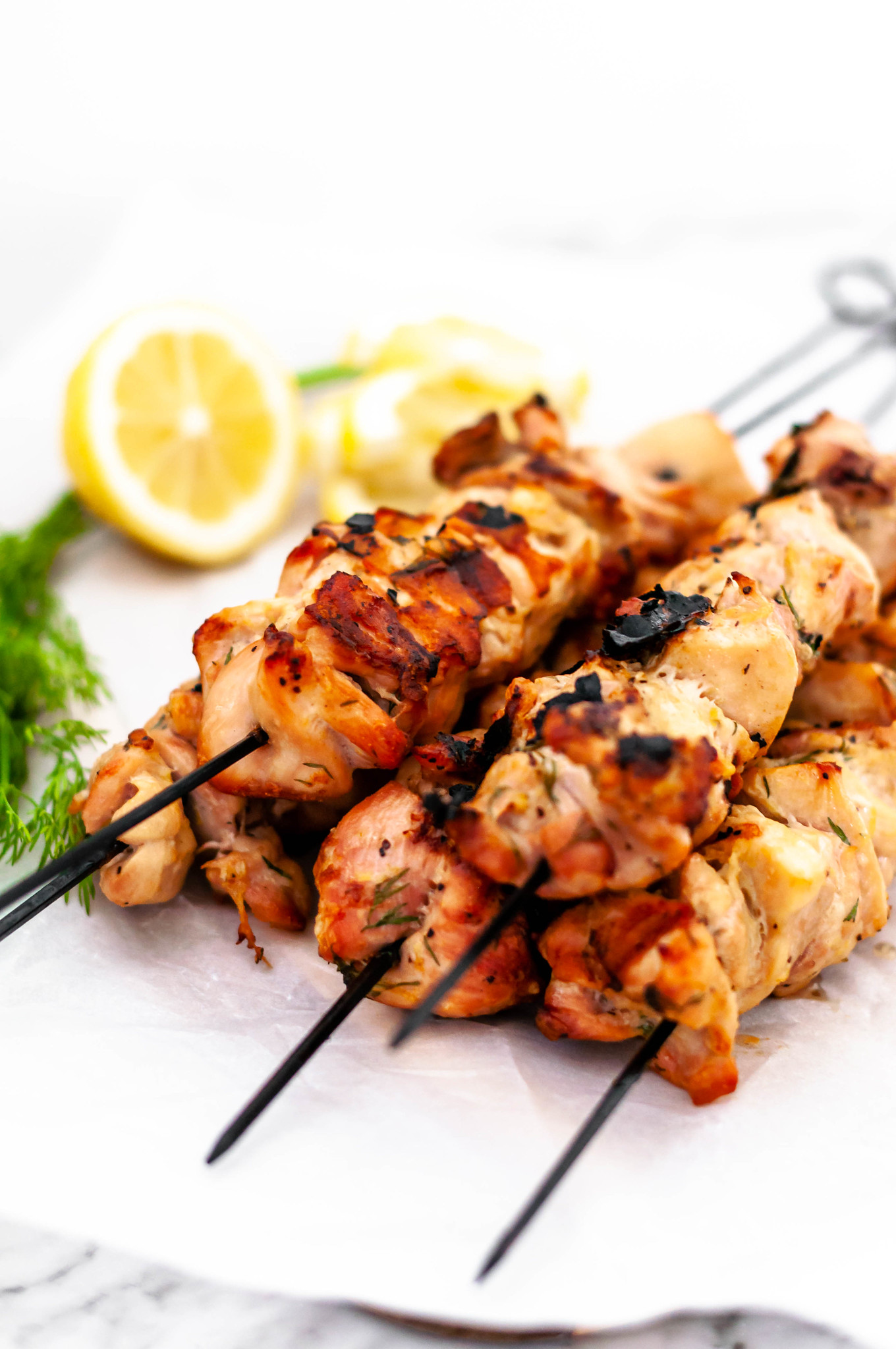 Lemon Dill Chicken Skewers are super simple weeknight meal to throw on the grill. Chicken marinated in lemon juice and zest, fresh dill, garlic, salt and pepper. Packed full of citrusy flavor.